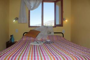 Una cama o camas en una habitación de Hospedaje Manantiales