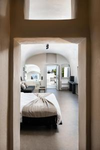 A bed or beds in a room at On The Rocks - Small Luxury Hotels of the World