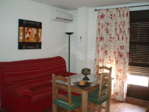 Zona de estar de Apartamentos Castillo de la Yedra