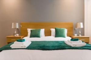 Un pat sau paturi într-o cameră la B&B Marina