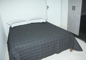 Cama o camas de una habitación en Flats Ferreira Atalaia Beach