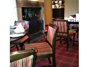 A restaurant or other place to eat at The White Hart at Lydgate