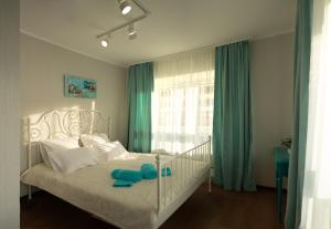 A bed or beds in a room at Elenasweethome Not far from airport Domodedovo