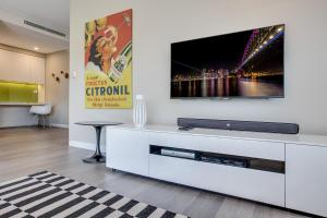 A television and/or entertainment center at Large and brand-new apartment close to city