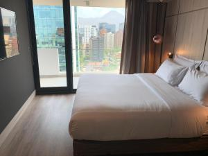 A bed or beds in a room at One Nk Apartments
