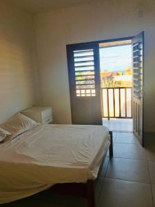 A bed or beds in a room at ITALIAN´S HOME ICARAI