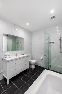 A bathroom at Renovated comfort in historic inner-city enclave