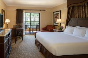 A bed or beds in a room at The Meritage Resort and Spa
