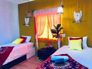 A bed or beds in a room at Boholand Hostel and Cafe