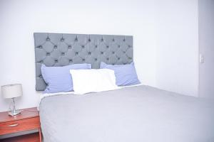 A bed or beds in a room at Apartment Carrera 301
