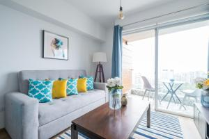A seating area at Simply Comfort - Panoramic Ocean Views with Rooftop Pool