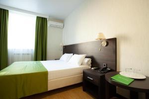 Кровать или кровати в номере Отель Экодом Сочи