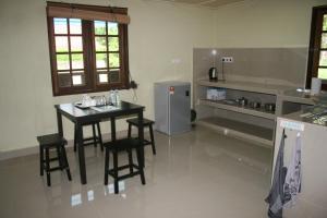 A kitchen or kitchenette at Balai Serama Guesthouse