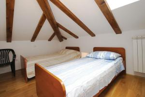 Кровать или кровати в номере Apartments Janks