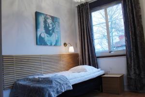 Säng eller sängar i ett rum på Hotell Äppelviken