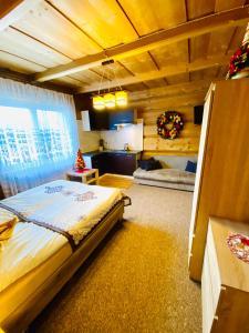 Łóżko lub łóżka w pokoju w obiekcie Willa Pod Stokiem
