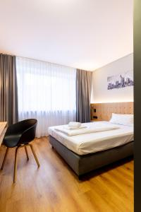 A bed or beds in a room at mk hotel frankfurt