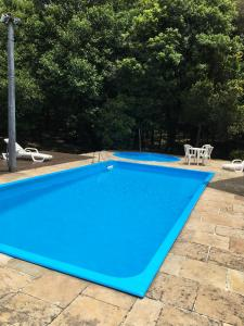 The swimming pool at or near Hotel Galo Vermelho