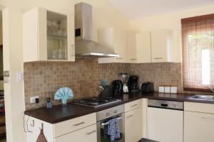 A cozinha ou cozinha compacta de Kunuku Villa
