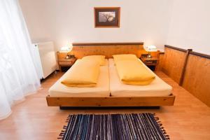 Ein Bett oder Betten in einem Zimmer der Unterkunft Hotel Hottentotten
