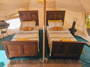 A bed or beds in a room at Wild Lotus Antigua