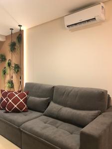 A seating area at Apartamento Vêneto