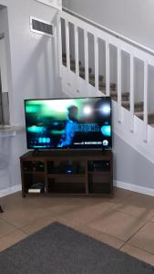 A television and/or entertainment centre at Townhouse in Orlando - near Disney