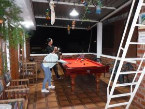 A pool table at Hostal D´Mathias