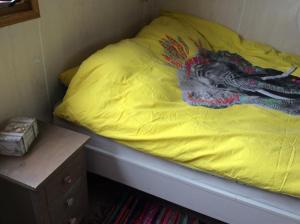 Ein Bett oder Betten in einem Zimmer der Unterkunft Repelsteeltje op Terschelling