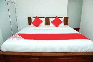 OYO 238 Selva's guest Houseにあるベッド