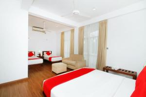 A bed or beds in a room at OYO 314 Neo Holiday Home