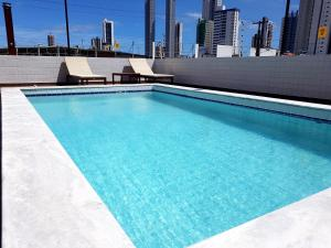 The swimming pool at or near Apartamentos Cézanne