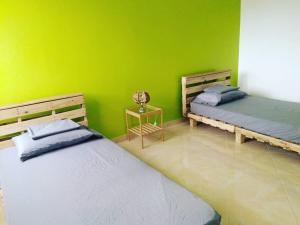 Un ou plusieurs lits dans un hébergement de l'établissement Tarrafal's Meeting Point