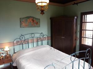 Ένα ή περισσότερα κρεβάτια σε δωμάτιο στο Ξενώνας Αγκωνάρι