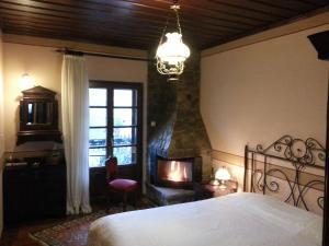 Łóżko lub łóżka w pokoju w obiekcie Guesthouse Agonari
