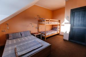 A bunk bed or bunk beds in a room at Samovar Hostel