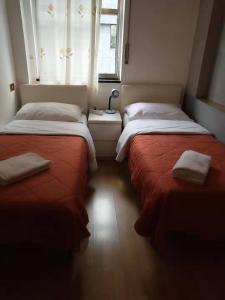 A bed or beds in a room at Wow