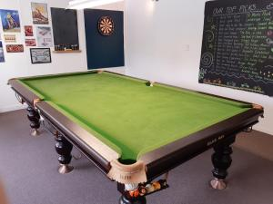 A pool table at Clive Colonial Cottages