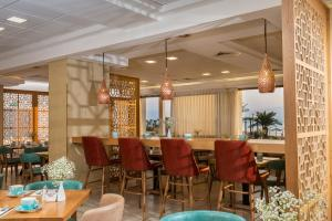 A restaurant or other place to eat at Oasis Dead Sea Hotel
