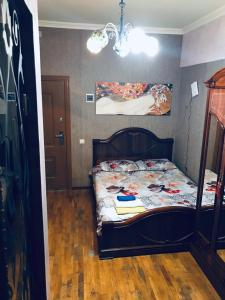 Кровать или кровати в номере Na Tylskoy
