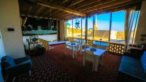 A restaurant or other place to eat at Khiva Rasulboy-Guest House