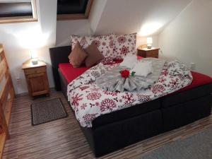 A bed or beds in a room at Privat Gazda Pension