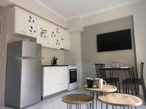 Η κουζίνα ή μικρή κουζίνα στο Angelland Luxury Suites