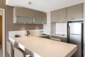 A kitchen or kitchenette at Chateau Royal Beach Resort & Spa, Noumea
