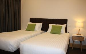 A bed or beds in a room at BIG4 Stuart Range Outback Resort