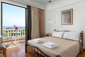 Panorama Hotel tesisinde bir odada yatak veya yataklar