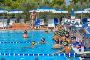 The swimming pool at or near Villaggio Orizzonte