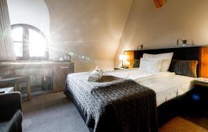 Łóżko lub łóżka w pokoju w obiekcie Uroczysko Siedmiu Stawów
