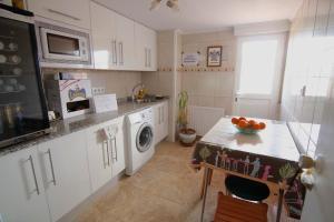 A kitchen or kitchenette at Casa Victoria