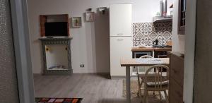 TV o dispositivi per l'intrattenimento presso Mansarde & Suite Maison 1706 Lago Orta